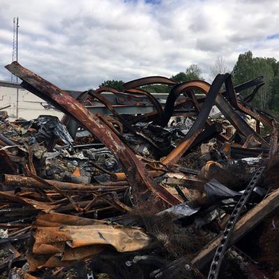 Ruiner efter branden på Händelö. Foto: Håkan Sjösvärd